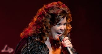 Wedding Entertainment Director® Elisabeth Scott Daley singing on stage in a Musical Theatre production.